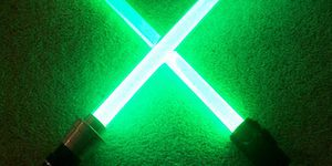 Two Crossed Green Lightsabers